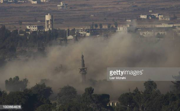 The aftermath of an explosion in Quneitra on the Syrian side of the IsraeliSyrian border is seen from the Israeli Golan Heights on July 22 2018 in...