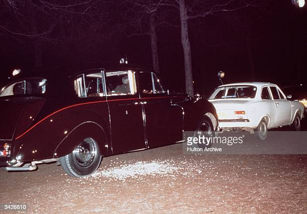 The aftermath of Ian Ball's attempt to kidnap Princess Anne, on The Mall, London, 20th March 1974. Ball's white Ford Escort is parked blocking the...