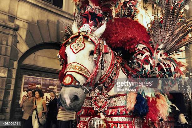 CONTENT] The afternoon parade carts decorated pride of Sicilian and immediately following the ride consisting of dozens of riders in costumes...