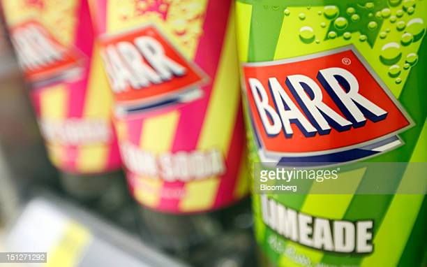 The AG Barr Plc company logo sits on bottles of soft drinks displayed for sale inside a William Morrison Supermarkets Plc grocery store in Erith UK...