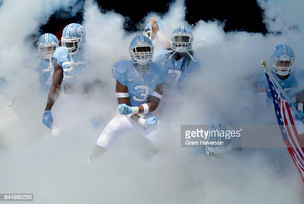 The against the North Carolina Tar Heels prepare to take the field for a game against the Louisville Cardinals during at Kenan Stadium on September 9...