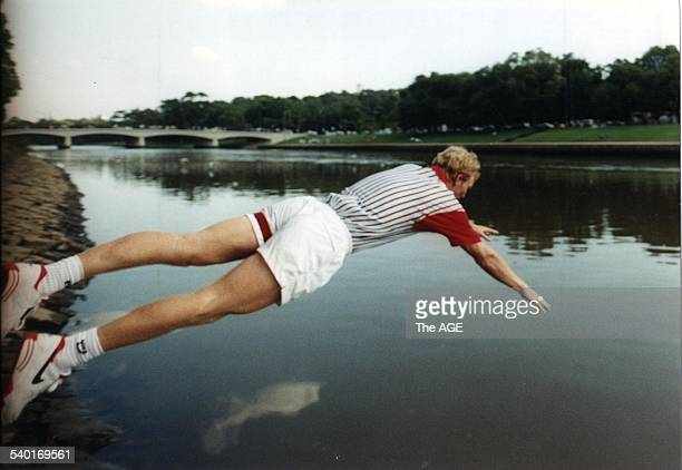 The Age of Tennis. Jim Courier dives into the Yarra to cool off after his second Australian Open title win in 1993. 1st February, 1993. THE AGE SPORT...