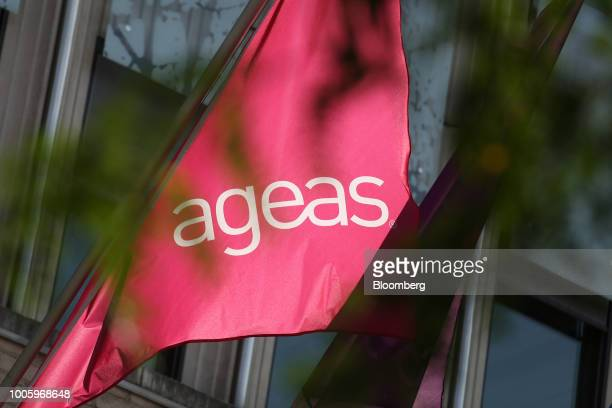 The Ageas logo sits on a flag flying outside the insurer's headquarters in Brussels Belgium on Thursday July 26 2018 Fosun International Ltd the...