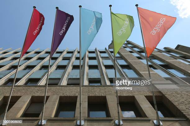 The Ageas logo sits on flags flying outside the insurer's headquarters in Brussels Belgium on Thursday July 26 2018 Fosun International Ltd the...