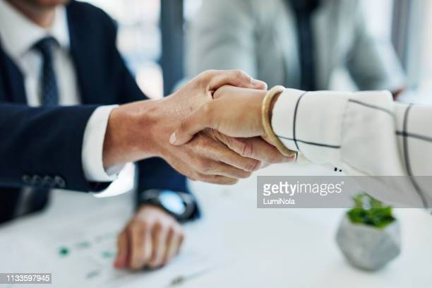 the agreement is binding - handshake stock pictures, royalty-free photos & images