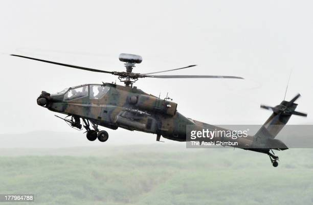 The AH64D groundattack helicopter known as the Apache of the Japan Ground SelfDefense Force participates in the Aug 25 military drill at the...