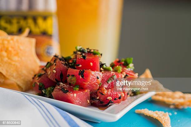 The Ahi Poke with green onions sesame shoyu and chili water at Hula Girl