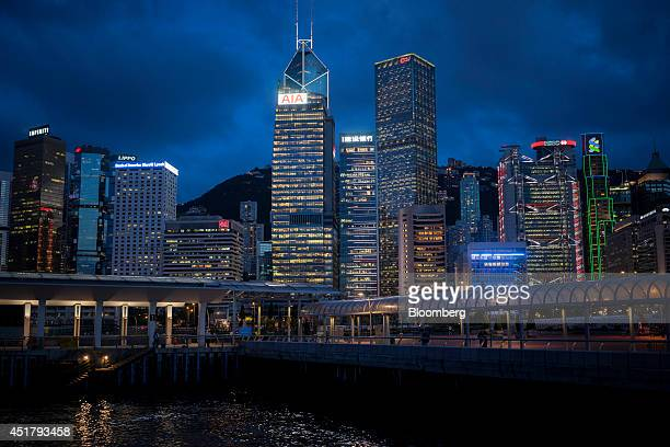 The AIA Central building center Bank of China Tower center rear Cheung Kong Center center right HSBC Holdings Plc headquarters fourth right and the...