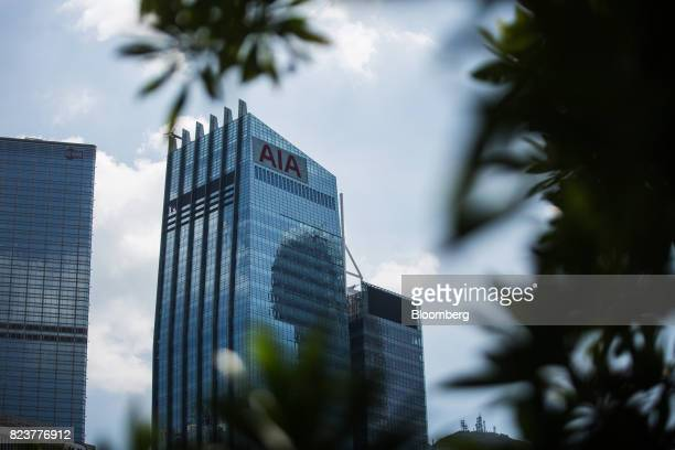 The AIA Central building which houses the headquarters of AIA Group Ltd center stands between the Cheung Kong Center left and the CCB Tower in Hong...