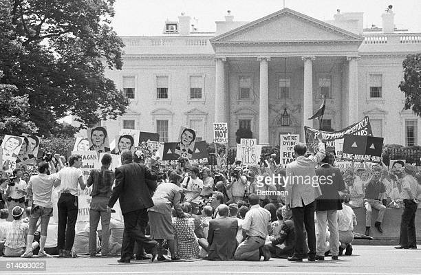 The AIDS protest group ActUp demonstrates in front of the White House demanding more money for AIDS research