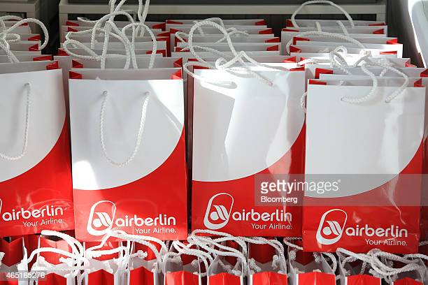 The Air Berlin logo sits on gift bags during the Air Berlin Plc news conference in Berlin Germany on Tuesday March 3 2015 Air Berlin Chief Executive...