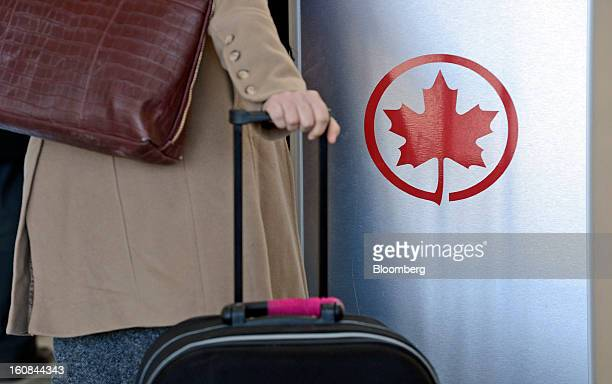 The Air Canada logo is seen next to a checkin area at Pearson International Airport in Toronto Ontario Canada on Wednesday Feb 6 2013 Air Canada the...