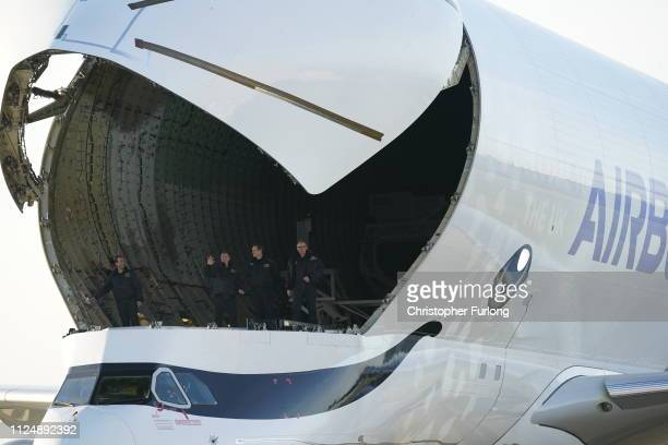 The air crew stand in the cargo bay of a new Airbus Beluga XL after its maiden flight to the UK at Airbus Broughton wing assembly plant on February...