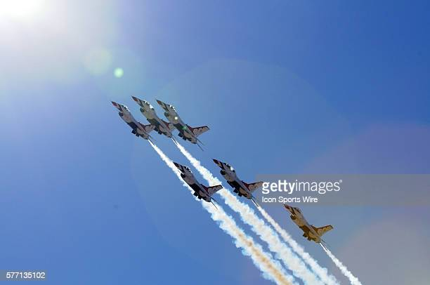 The Air Force F16's Thunderbirds execute a flyover prior to the NASCAR Sprint Cup Series UAWDodge 400 at Las Vegas Motor Speedway in Las Vegas NV