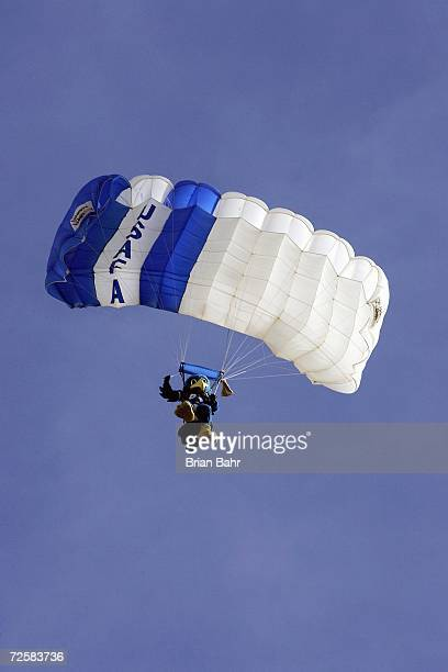 The Air Force Mascot paratrooper decends to the field before the game between the Notre Dame Fighting Irish and the Air Force Falcons on November 11...