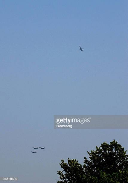 The Air Force missing man formation is done during the flyover over the US Capitol as part of the procession of Former President Ronald Wilson...