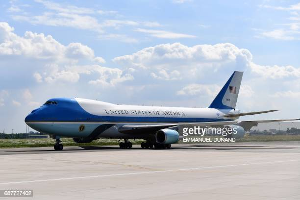 The Air Force One plane transporting US President Donald Trump and First Lady Melania Trump arrives at the Melsbroek military airport in...