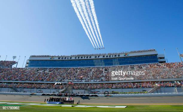 The Air Force Thunderbirds fly over before the 60th running of the Daytona 500 on February 18 at the Daytona International Speedway in Daytona Beach...
