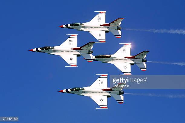 The Air Force Thunderbirds team flying their F16 Fighting Falcons perform aerobatic maneuvers May 6 2001 on day two of the twoday Air Sea Show's...