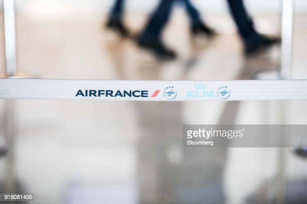 The Air FranceKLM Group logo sits on a retractable belt barrier at Charles de Gaulle airport operated by Aeroports de Paris in Paris France on Monday...