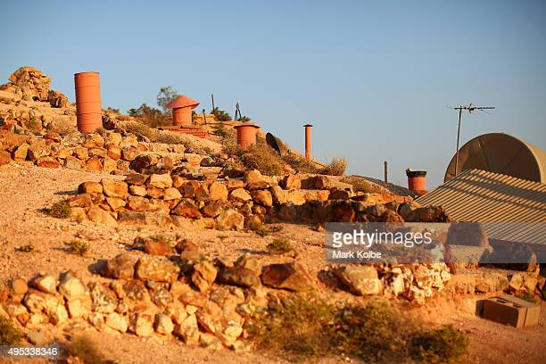 The air vents from dugouts' as locals call underground homes are seen on October 22 2015 in Coober Pedy Australia Coober Pedys sandstone is perfectly...