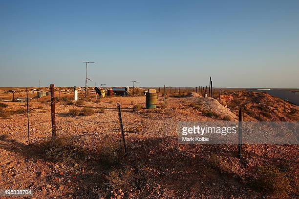 The air vents from dugouts as locals call underground homes are seen on October 22 2015 in Coober Pedy Australia Coober Pedys sandstone is perfectly...