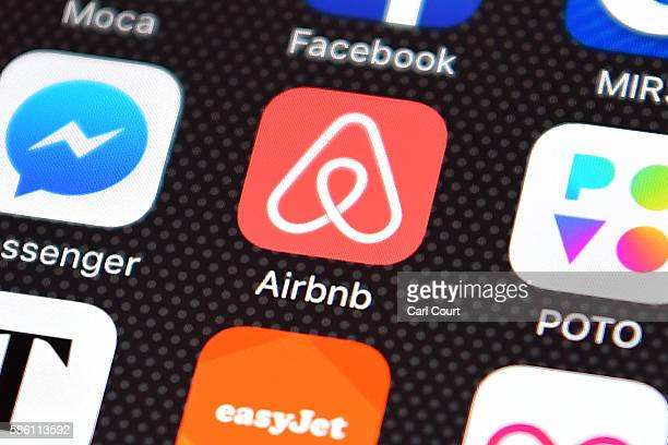 The Airbnb app logo is displayed on an iPhone on August 3 2016 in London England