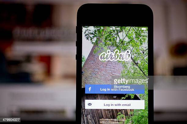 The Airbnb Inc application and website are displayed on an Apple Inc iPhone and iPad in this arranged photograph in Washington DC US on Friday March...