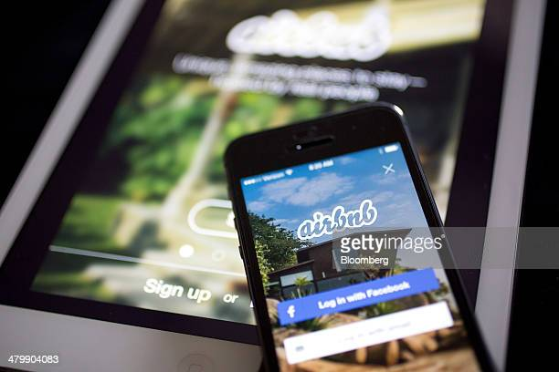 The Airbnb Inc application is displayed on an Apple Inc iPhone and iPad in this arranged photograph in Washington DC US on Friday March 21 2014...