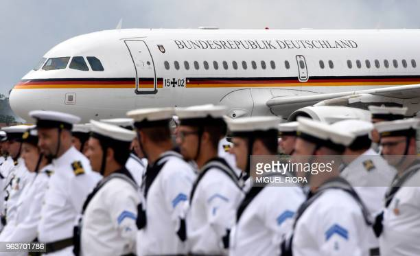 The Airbus A319 aircraft used by German Chancellor Angela Merkel lands at the Francisco Sa Carneiro airport in Porto on May 30 2018 German Chancellor...