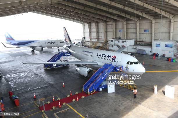 The Airbus A319 operated by LATAM Airlines which will transport Pope Francis during his upcoming visit to Peru is pictured at a hangar before its...