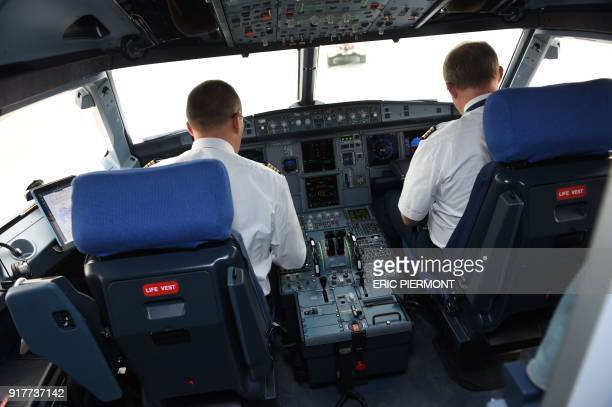 The Airbus A321 LR neo test plane pilots work in the cockpit after landing at Le Bourget airport near Paris after its first transatlantic flight on...