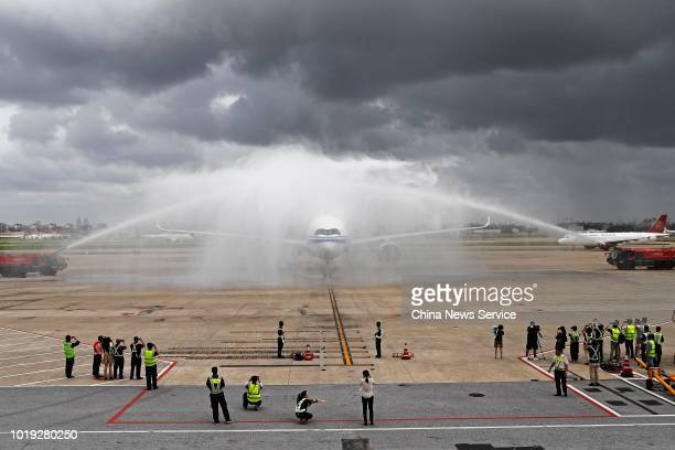 The Airbus A350900 of Air China is seen during a water salute at Shanghai Hongqiao International Airport on August 14 2018 in Shanghai China The...