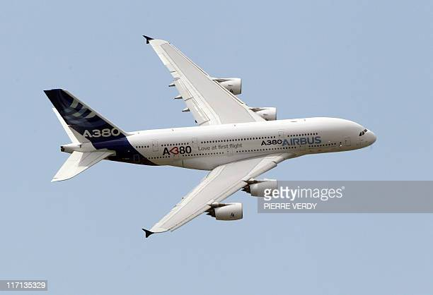 The Airbus A380 jetliner which was damaged in a ground incident on June 19 performs its flying display at the Paris International Air Show on June 23...