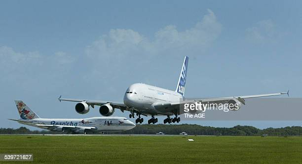 The Airbus A380 the largest passenger aircraft in the world lands at Brisbane Airport in front of a 747 400 12 November 2005 THE AGE Picture by PAUL...