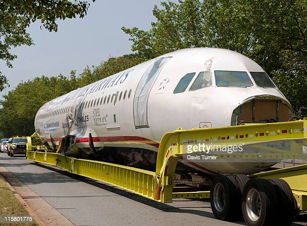 The Airbus jet that pilot Chesley Sully Sullenberger landed on the Hudson River is pulled along Yorkmont Road as it makes its way to the Carolinas...