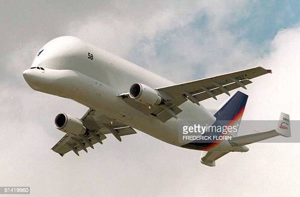 The AirbusDBA cargo plane Beluga flys over the airport at Le Bourget outside Paris during a demonstration during the 41st Bourget International Air...