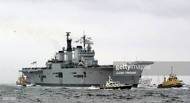 The aircraft carrier HMS Ark Royal returns to her base 126 days after she set sail May 17 2003 in Portsmouth England The ship acted as The Royal...