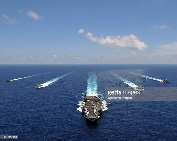 The aircraft carrier USS Abraham Lincoln leading a formation of ships from the Abraham Lincoln Strik