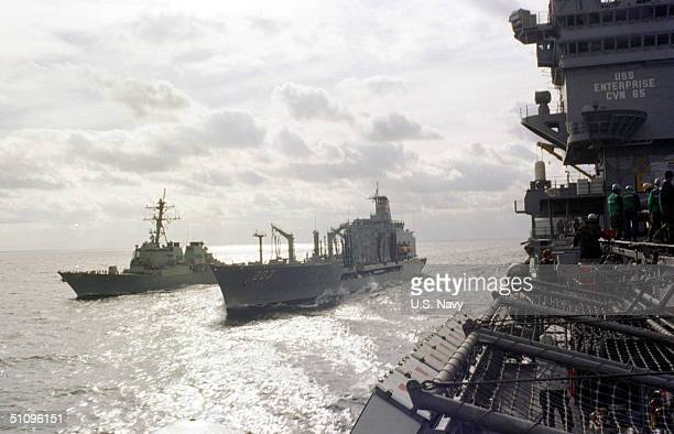 The Aircraft Carrier USS Enterprise And The Guided Missile Destroyer USS Gonzales Calls An Emergency Break Away Drill During Underway Replenishment...