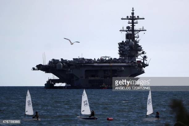The aircraft carrier USS George H W Bush is moored outside Piraeus port southwest from Athens on March 5 2014 The 1092 feet carrier which can carry...
