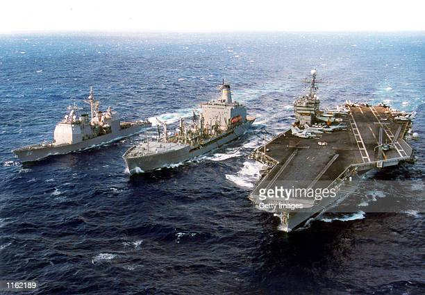 The aircraft carrier USS John F Kennedy takes on fuel during an under way replenishment at sea with the Military Sealift Command ship USNS John...