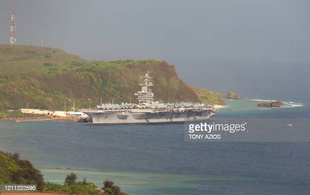 The aircraft carrier USS Theodore Roosevelt, is docked at Naval Base Guam in Apra Harbor amid the coronavirus pandemic on Monday, April 27, 2020. -...