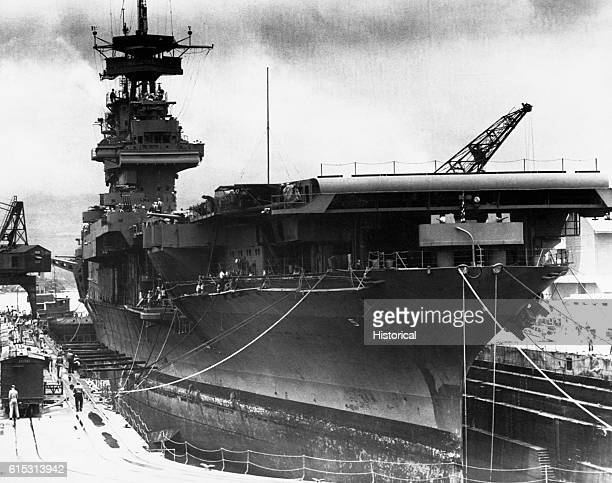 The aircraft carrier USS Yorktown is in dry dock at Pearl Harbor being readied for the Battle of Midway June 1942
