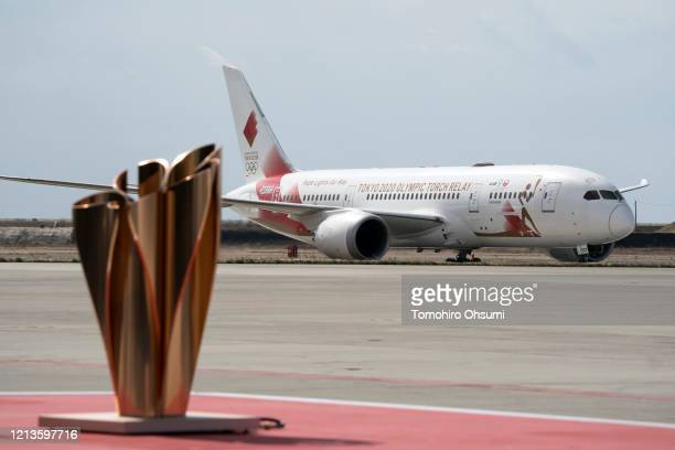 The aircraft transporting the Olympic flame taxes after landing at the Japan Air SelfDefense Force Matsushima Air Base ahead of the Tokyo 2020...