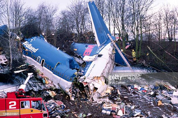 The aircraft wreckage from British Midland Airways flight 092 sits on the grass embankment of the M1 motorway near East Midlands airport after crash...