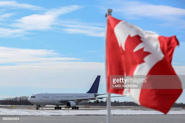 The airplane carrying King Philippe and Queen Mathilde of Belgium arrives at Ottawa International Airport in Ottawa Ontario on March 11 2018 / AFP...