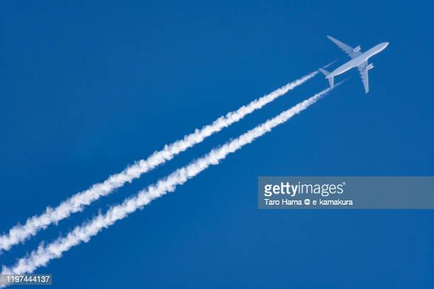 the airplane flying in the blue sky in japan - air vehicle stock pictures, royalty-free photos & images