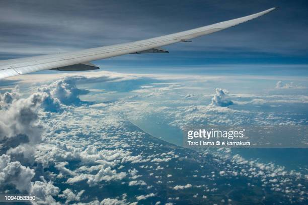 The airplane flying on Brunei Darussalam and South China Sea daytime aerial view from airplane