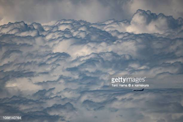 The airplane flying on cumulus clouds on Pacific Ocean in Taiwan daytime aerial view from airplane